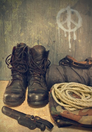 Army boots on the background wall with a sign of pacifism