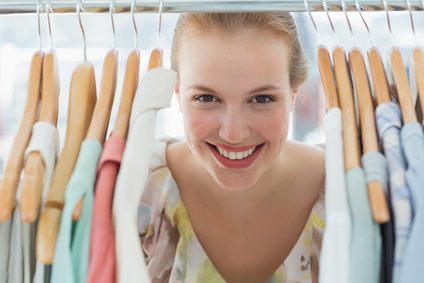 [image]-happy female customer amid clothes rack